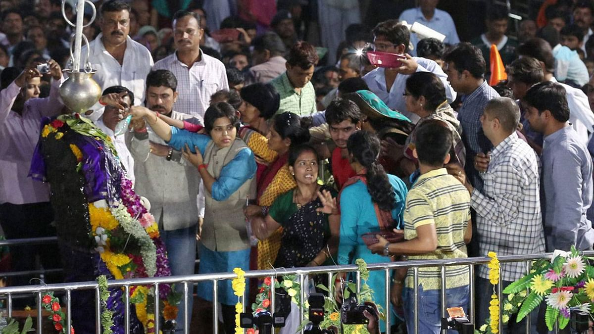 Trupti Desai of the Bhumata Brigade offers prayers at the Shani Shingnapur temple once it was open to women. (Photo: PTI)