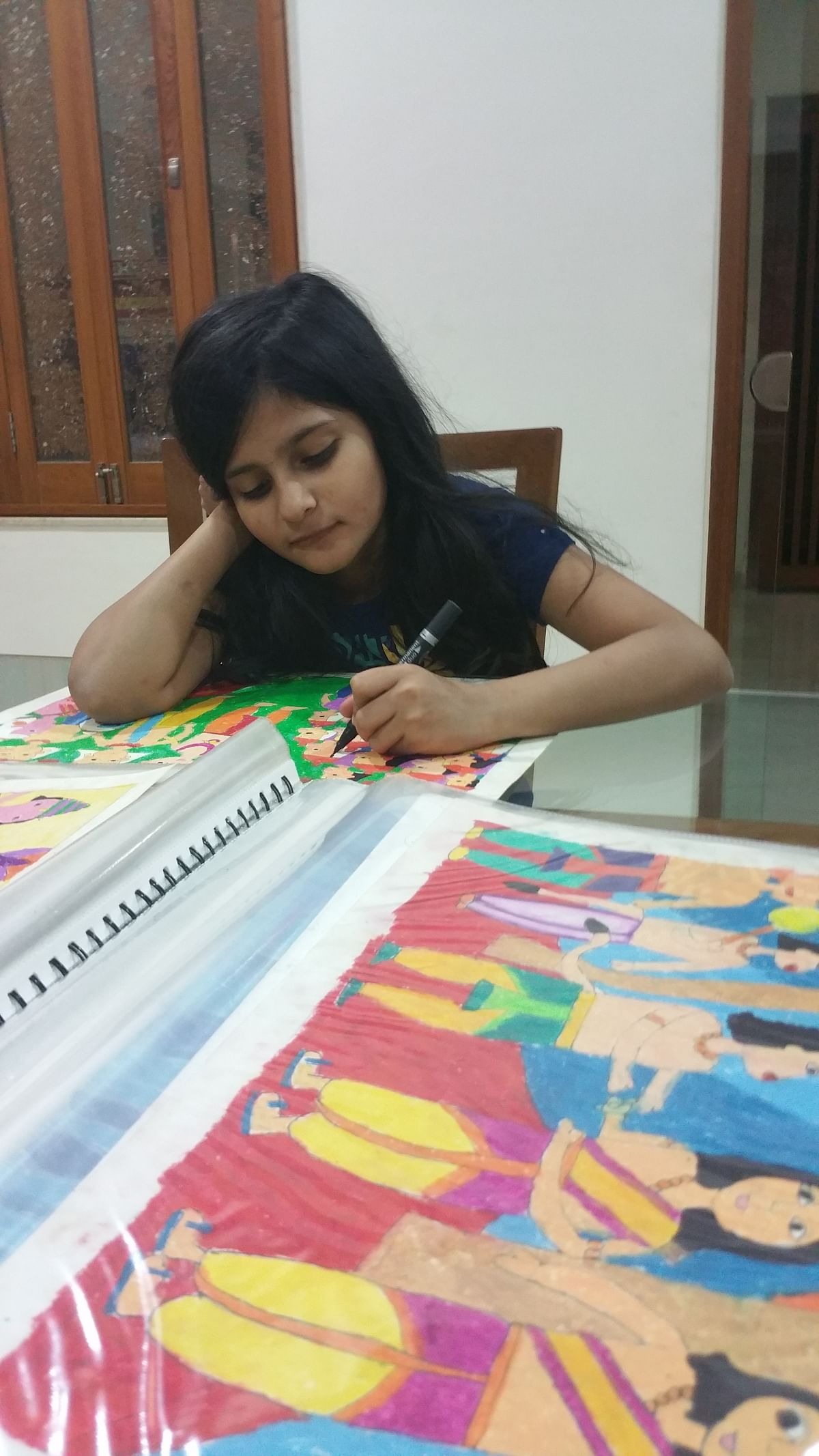This March, the now 10-year-old has completed 35 paintings based on the 60 stanzas of the scripture.(Photo Courtesy: Priya Adhyaru Majithia)