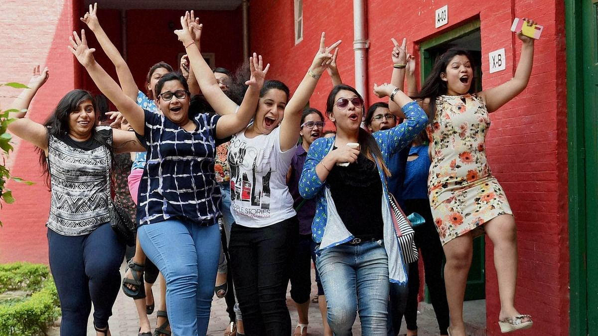 Students celebrate after CBSE results.