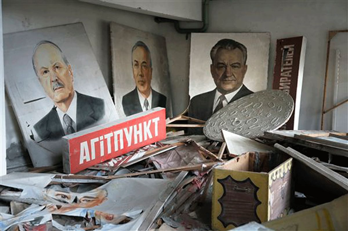 Abandoned portraits of Soviet leaders covered in radioactive dust at a home in Pripyat, Ukraine. The pictures were to be paraded at the celebratory May Day rally that would cross the town, a week later. (Photo: AP)