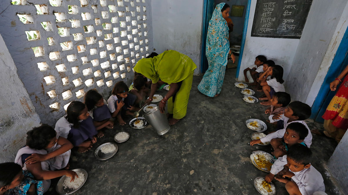 Enrolment in schools on account of the Mid-Day Meal scheme should not be seen as an indicator of the quality of education. (Photo: Reuters)