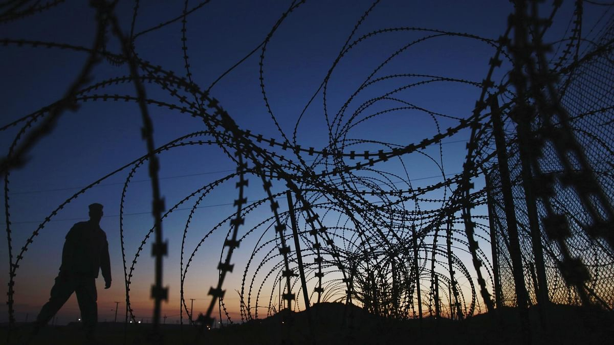 A soldier walks past concertina wire surrounding the outside of Joint Task Force Guantanamo's Camp Delta at the U.S. Naval Base in Guantanamo Bay, Cuba.(Photo: Reuters)