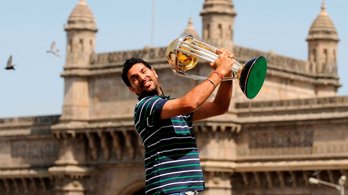 India's Yuvraj Singh lifts the trophy at the Taj hotel the day after India defeated Sri Lanka in the ICC Cricket World Cup final in Mumbai.