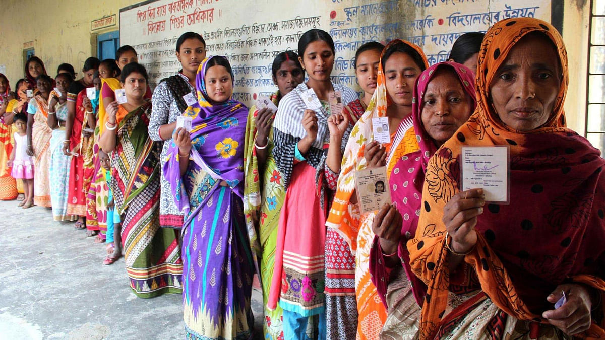 Women show their voter's identity card as they queue up to cast their  votes during the second phase of West Bengal Legislative Assembly polls  in South Dinajpur, April 17, 2016. (Photo: IANS)