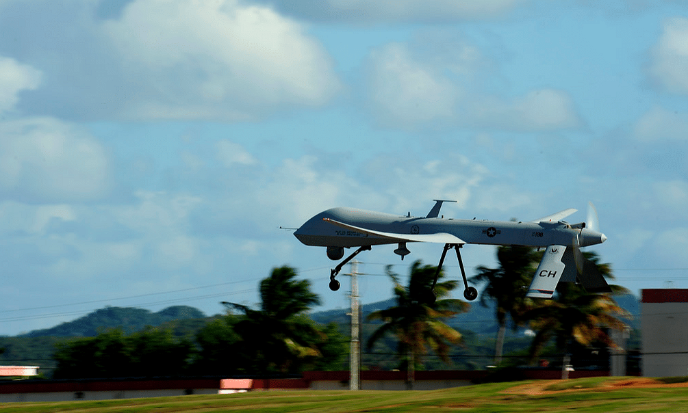 """An RQ-1 Predator unmanned aerial vehicle from the 432nd Wing out of Creech Air Force Base, Nev., takes off from Aeropuerto Rafael Hernandez outside Aguadilla, Puerto Rico, Jan. 28, 2010. (Photo:<a href=""""https://www.flickr.com/photos/39955793@N07/4312154623/""""> defense.gov</a>)"""