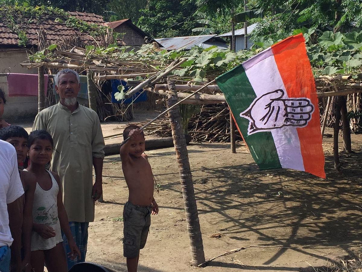 A child seen holding a Congress flag in Assam. (Photo: Tridip K Mandal/ <b>The Quint</b>)