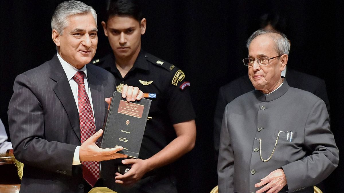 President Pranab Mukherjee looks on as Chief Justice of India Justice T S Thakur releases the book 'Statement of Indian law: Supreme Court through its Constitution Bench Decisions since 1950' at Auditorium, Rashtrapati Bhavan. (Photo: PTI)