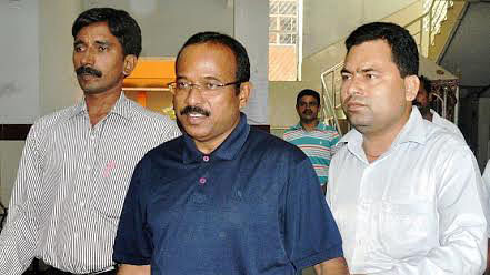 """The convicted politician (Centre) being taken away by CBI. (Photo courtesy: <a href=""""http://www.orissadiary.com/"""">www.orissadiary.com</a>)"""