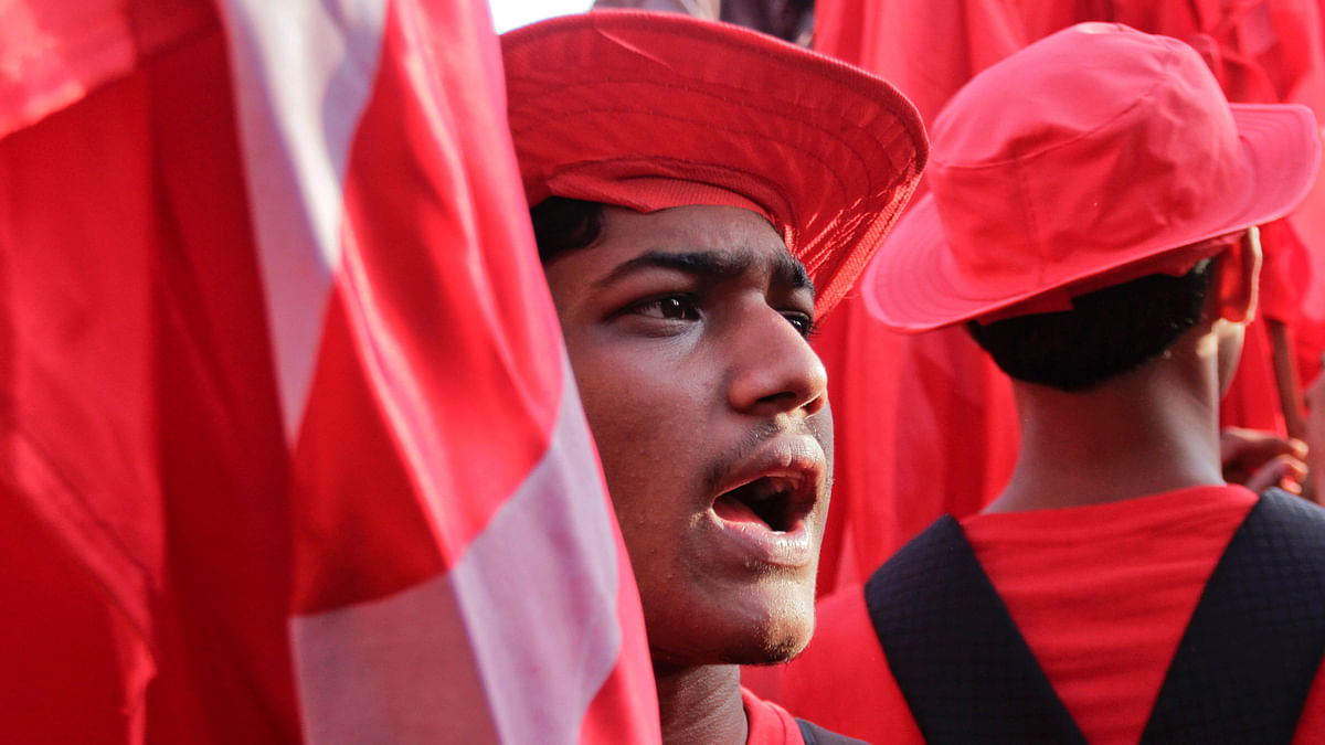 A cadre of Communist Party of India-Marxist (CPI-M) in red uniform shouts slogans during an election rally in Kolkata. (Photo: AP)
