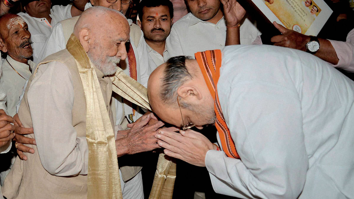 BJP President Amit Shah being blessed by an elderly man during a public programme on the occasion of the BJP's foundation day at Mavalankar Hall in New Delhi on Wednesday. (Photo: PTI)