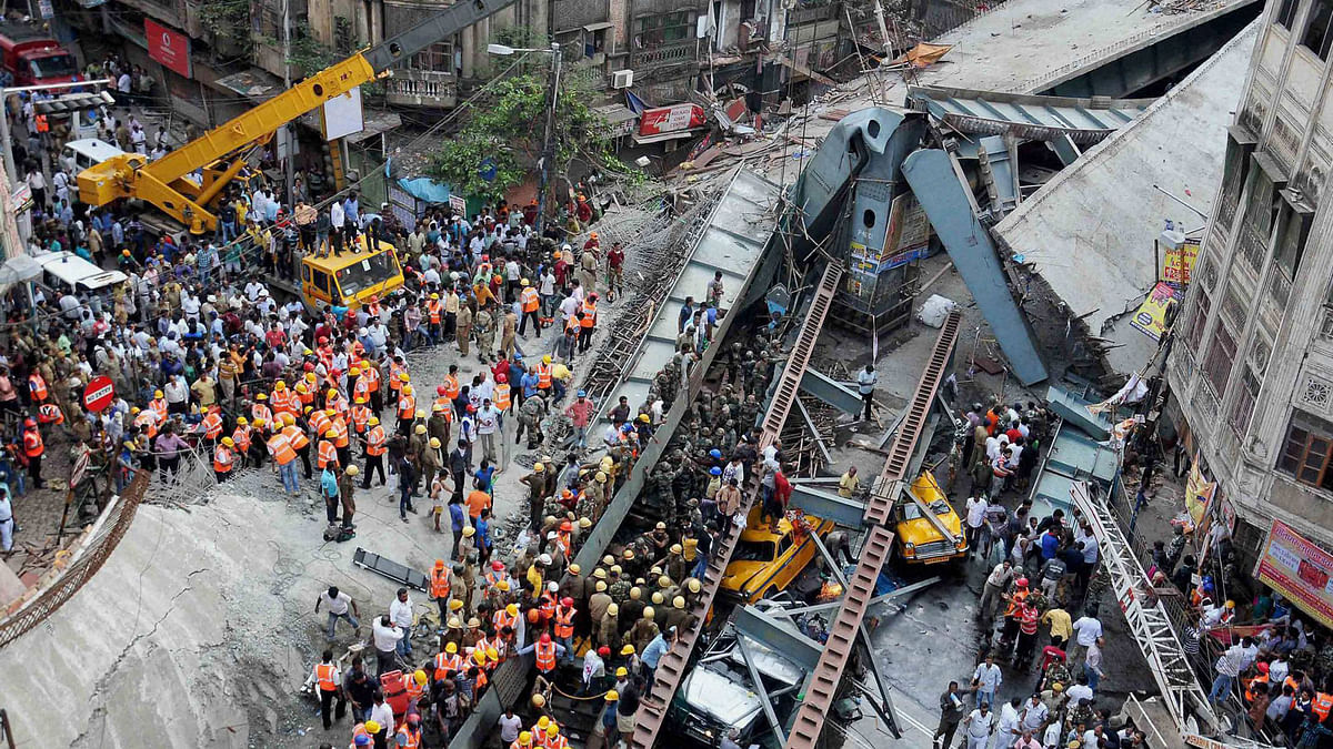 Rescue operations going on after an under-construction flyover collapsed on Vivekananda Road in Kolkata on Thursday. (Photo: PTI)