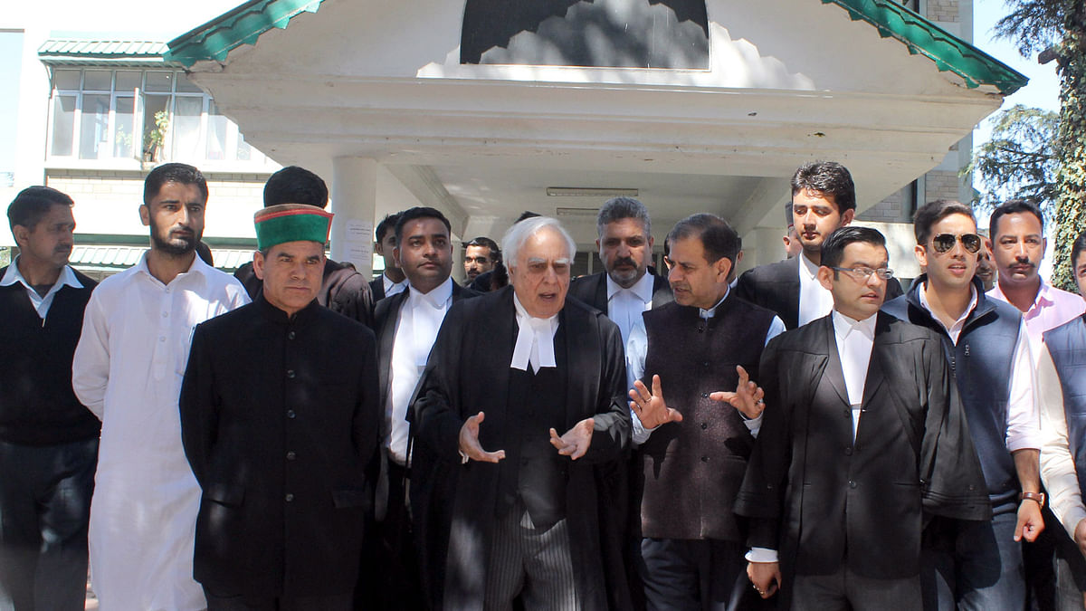 Congress leader and lawyer Kapil Sibal comes out of Himachal Pradesh High Court after pleading for Himachal CM Virbhadra Singh in a disproportionate assets case in Shimla on 1 October 2015. (Photo: IANS)
