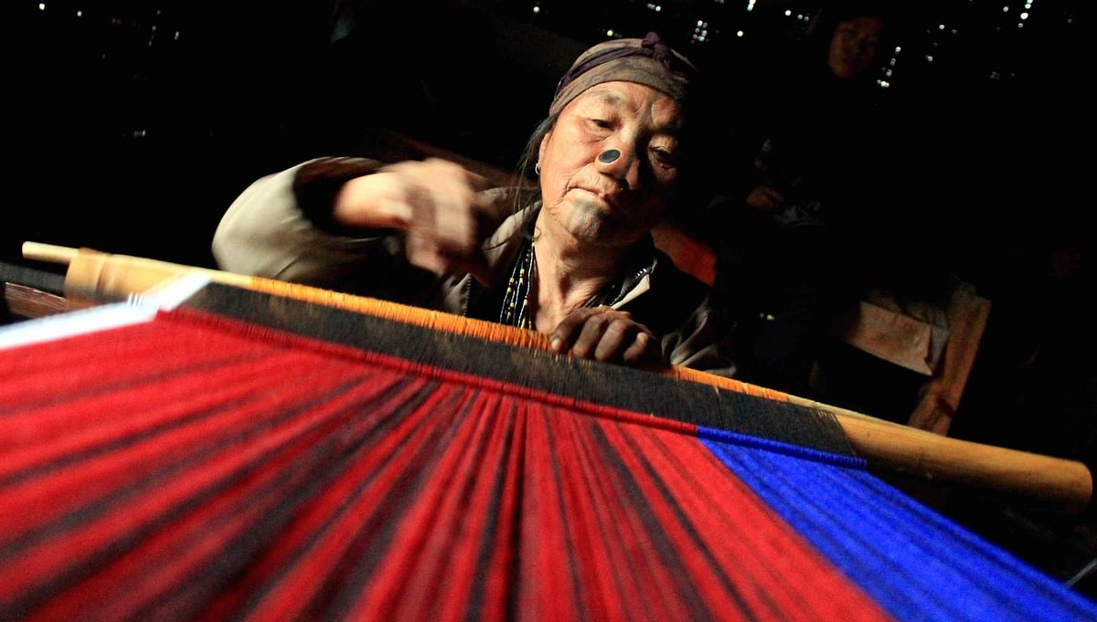 An elderly Apatani lady weaves a traditional shawl (Photo: Priyamvada Sinha)