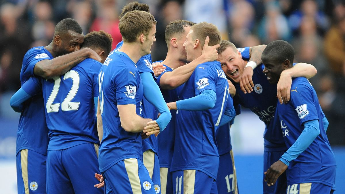 Leicester's players celebrate after scoring against Swansea on Sunday. (Photo: AP)