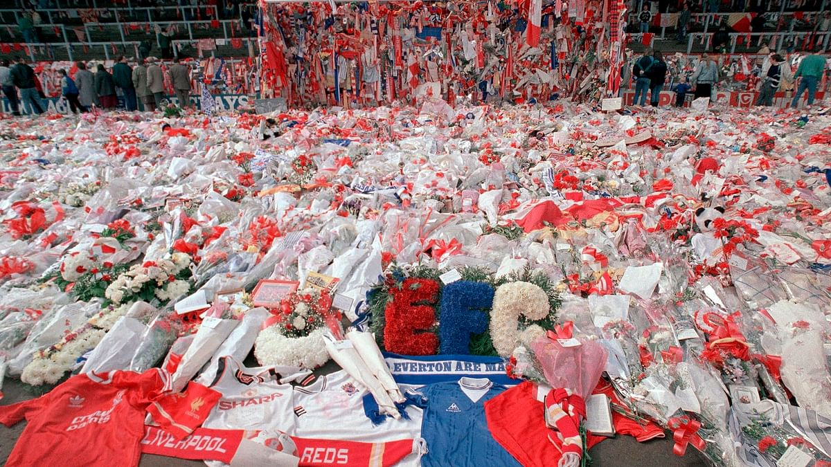 Floral tributes are placed by soccer fans at the 'Kop' end of Anfield Stadium in Liverpool. (Photo:AP)