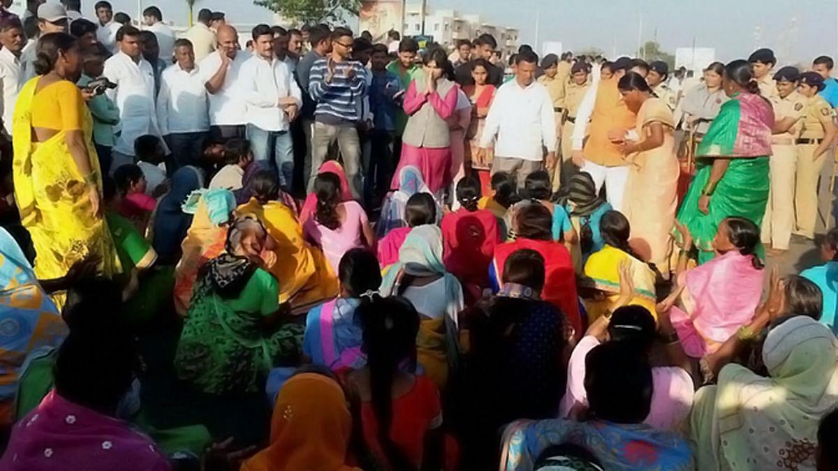 File photo of Trupti Desai with the locals. (Photo: PTI)