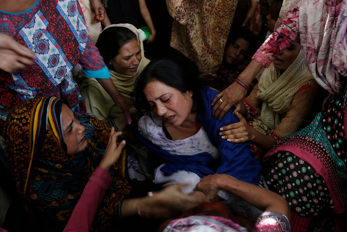 A woman mourns the death of her son in a suicide bombing in Lahore that killed over 70 people.       (Photo: AP)