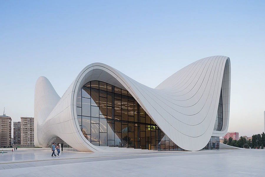 """Heydar Aliyev Centre, Baku, Azerbaijan (2011). Stunning curves that leave your eyes wandering at all times. This building won the London Design Museum award in 2014. One judge even called it """"as pure and sexy as Marilyn's blown skirt"""". (Photo Courtesy: Zaha Hadid <a href=""""http://www.zaha-hadid.com/archive"""">Website</a>)"""