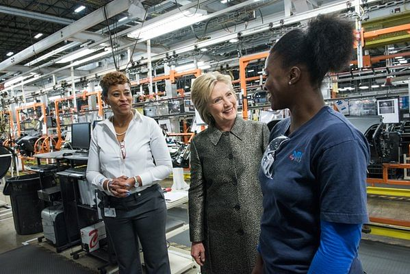 """Hillary Clinton with factory workers. (Photo: <a href=""""https://twitter.com/HillaryClinton/status/717748413698347013"""">Twitter/HillaryClinton</a>)"""