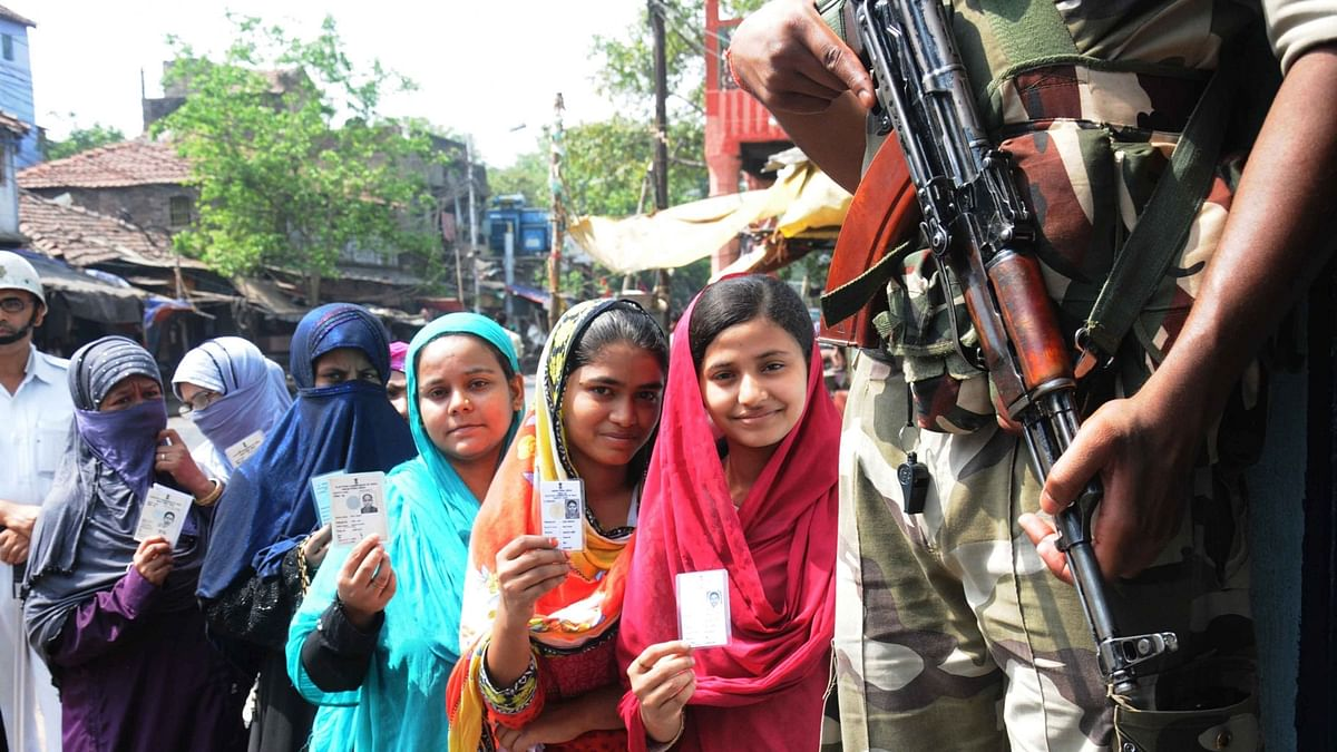 Muslim women showing their fingers marked with phosphorous ink after casting their vote at the polling station during the West Bengal Assembly Election in Kolkata on 21 April 2016. (Photo: IANS)