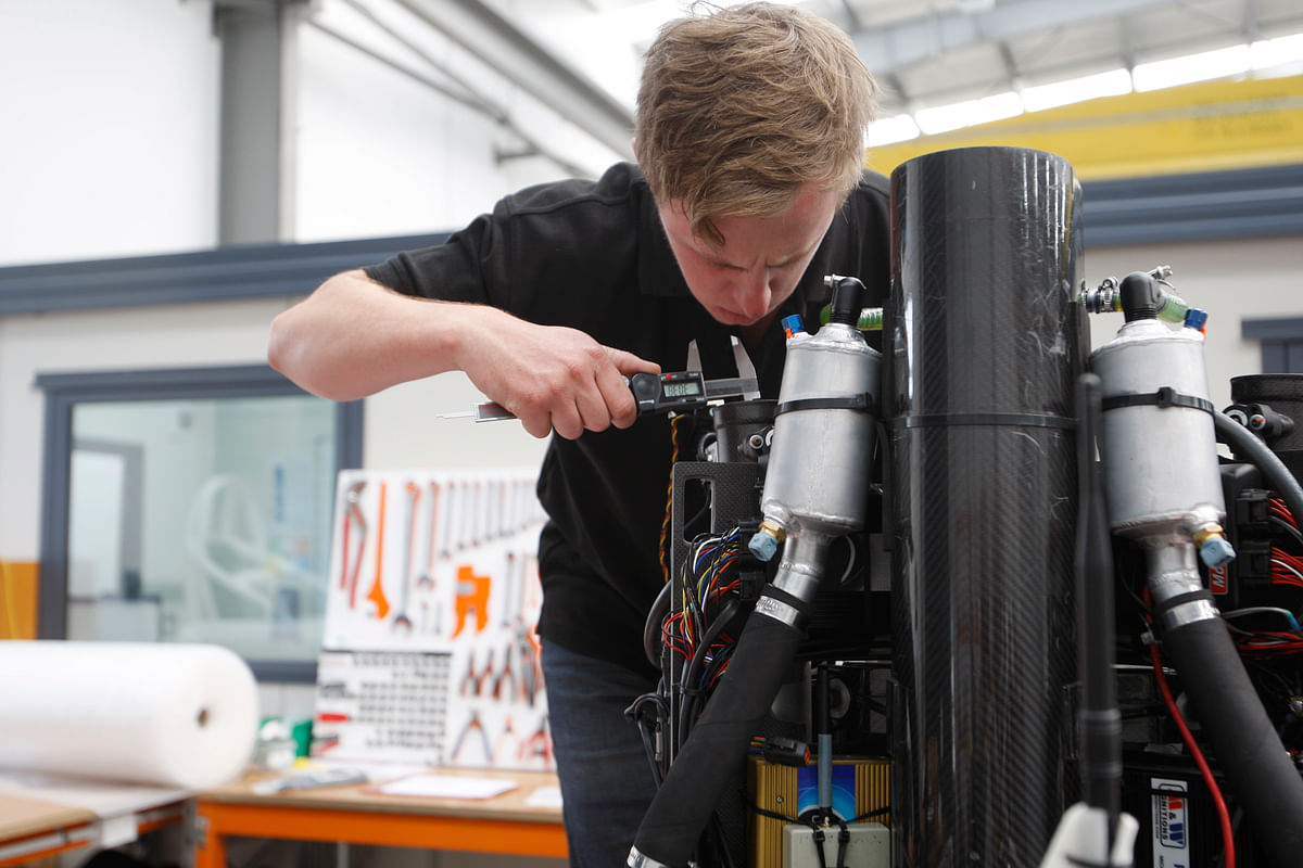 Technician Simon Jones works on a jetpack at the Martin Aircraft Co. headquarters in Christchurch, New Zealand. (Photo: AP)
