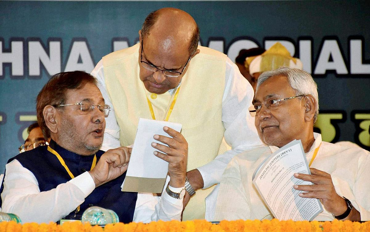 Bihar Chief Minister and newly elected JD(U) President Nitish Kumar and senior party leaders Sharad Yadav and KC Tyagi at the party's National Council Meeting. (Photo : PTI)