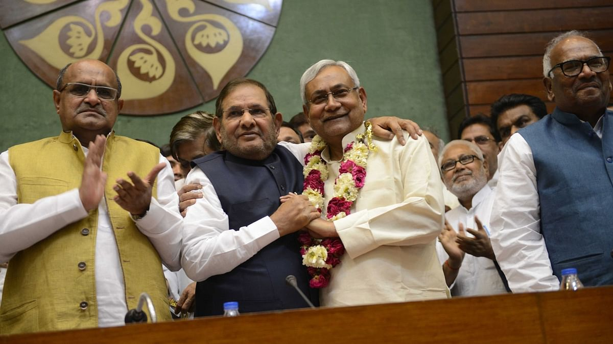 Bihar Chief Minister Nitish Kumar who has been elected the president of JD (U) being greeted by outgoing president Sharad Yadav in New Delhi, on April 10, 2016.  (Photo: IANS)