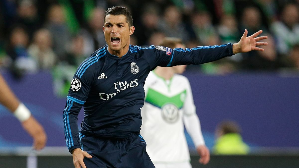 Cristiano Ronaldo argues a referee decision during the Champions League match against Wolfsburg. (Photo: AP)