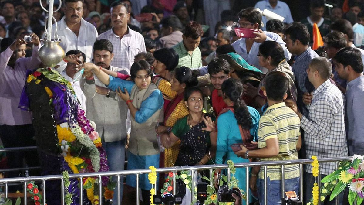 Bhumata Brigade chief Trupti Desai offering prayer at the Shani Shingnapur temple after the gates were opened for women, in Ahmednagar on Friday. (Photo: PTI)