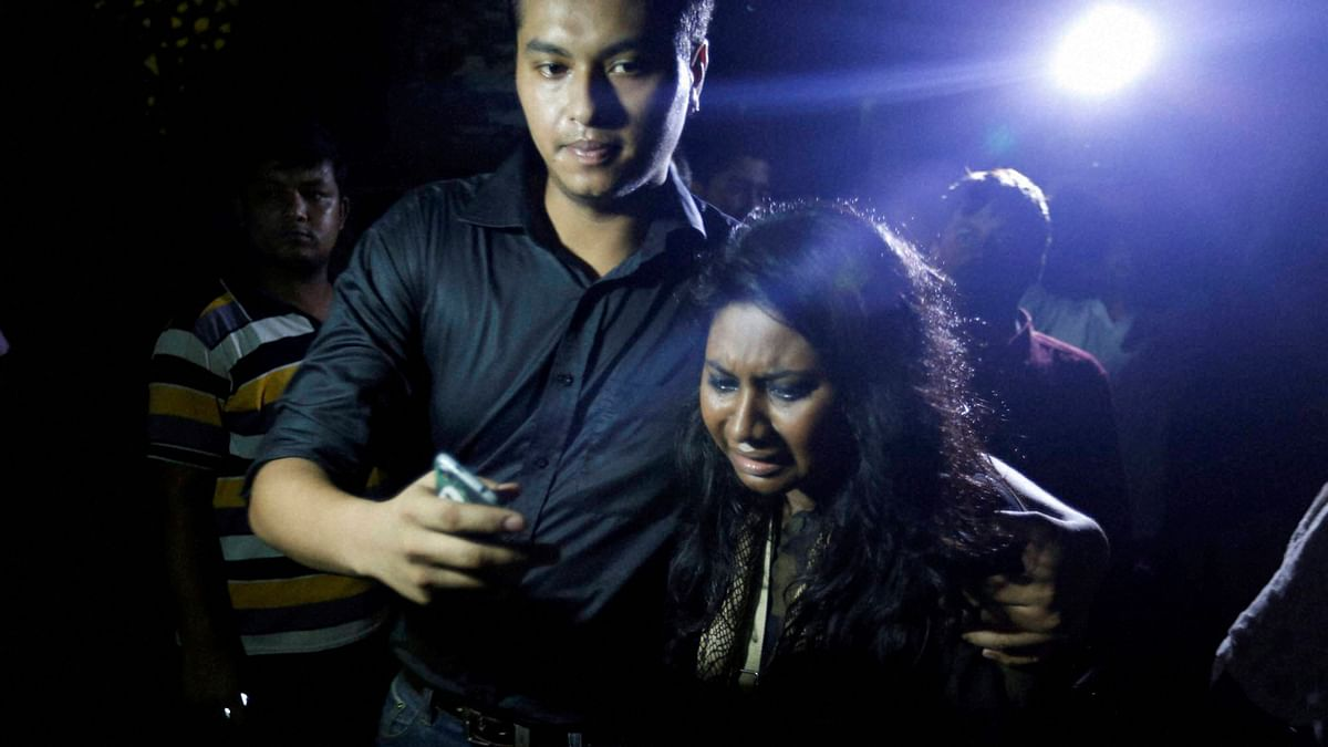 An unidentified co worker of U.S. Agency for International Development, (USAID) employee Xulhaz Mannan who was stabbed to death wails as she returns from the crime spot in Dhaka, Bangladesh. (Photo: PTI)