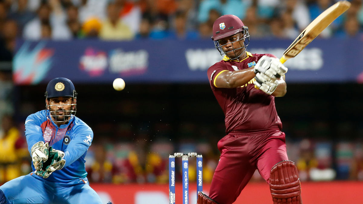Johnson Charles and MS Dhoni in action during the World T20 semi-final between India and West Indies at Mumbai. (Photo: AP)