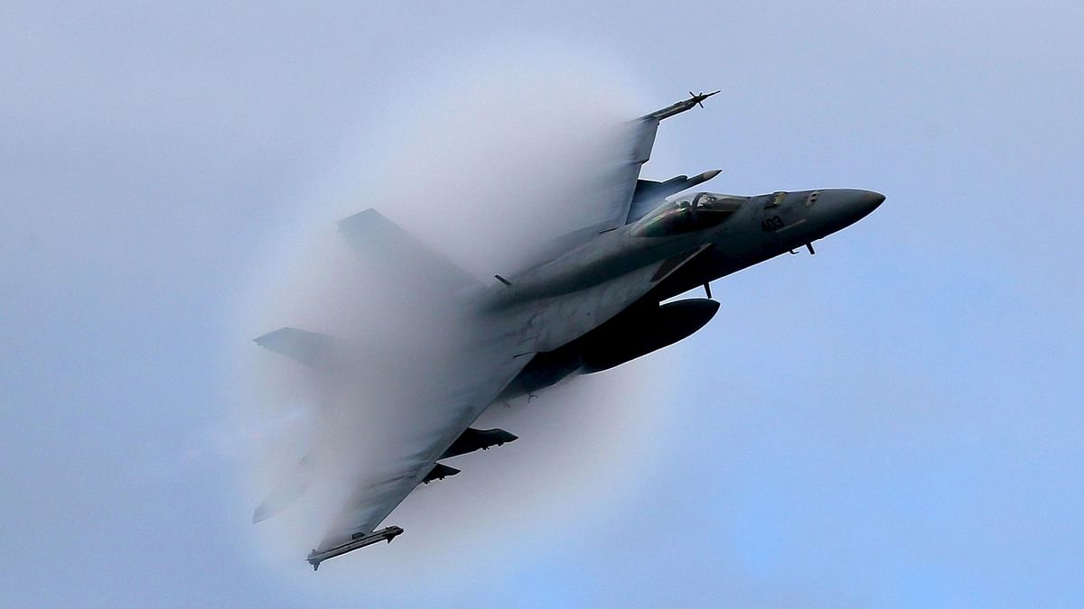 File photo of a F18 Super Hornet creates a vapor cone as it flies at a transonic speed. (Photo: Reuters)