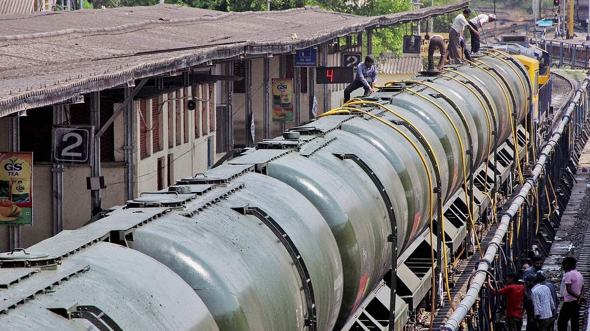 Workers fill water in Central Railway train tanks to transport to drought affected Latur District from Miraj station near Sangli on Sunday. (Photo: PTI)