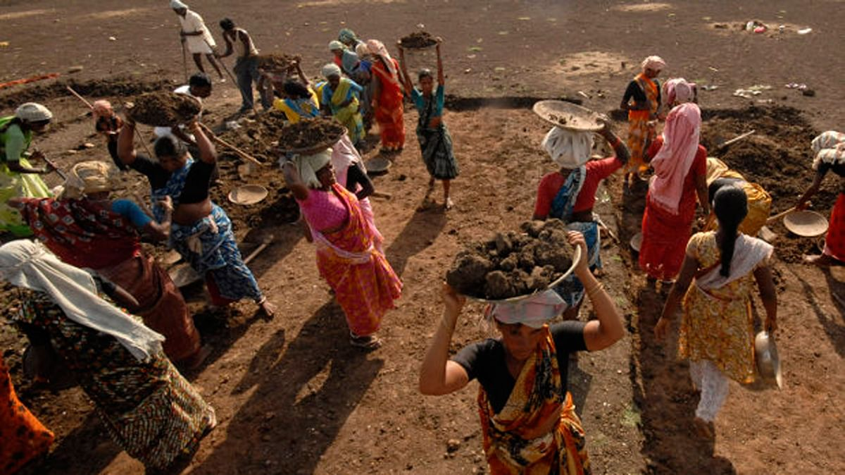 Labourers work on a dried lake it under the Mahatma Gandhi National Rural Employment Guarantee Act on the outskirts of Hyderabad.