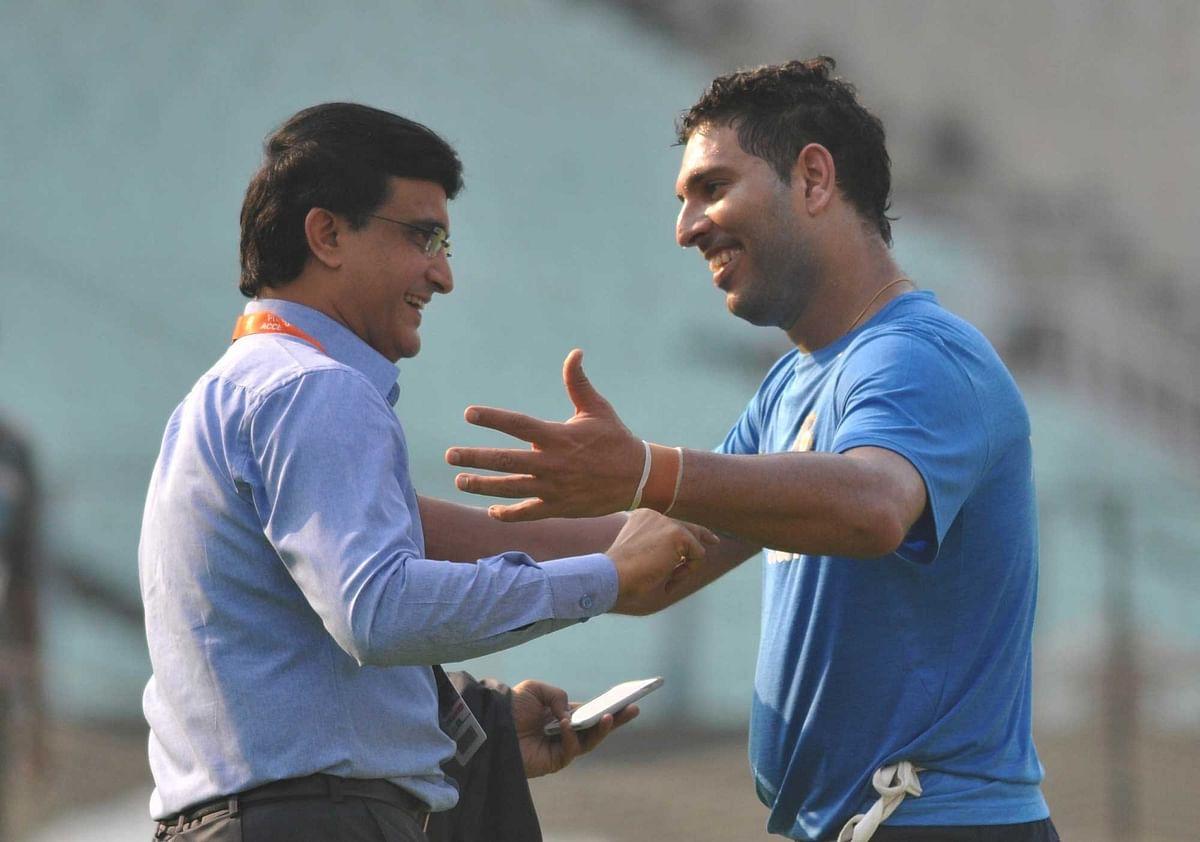 Sourav Ganguly(President CAB) with Yuvraj Singh. (Photo: PTI)