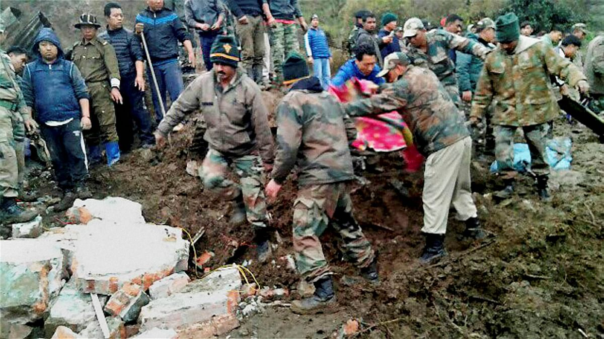 Army men carry out rescue works after landslide at village Phamla in Tawang district of Arunachal Pradesh on Friday. (Photo: PTI)