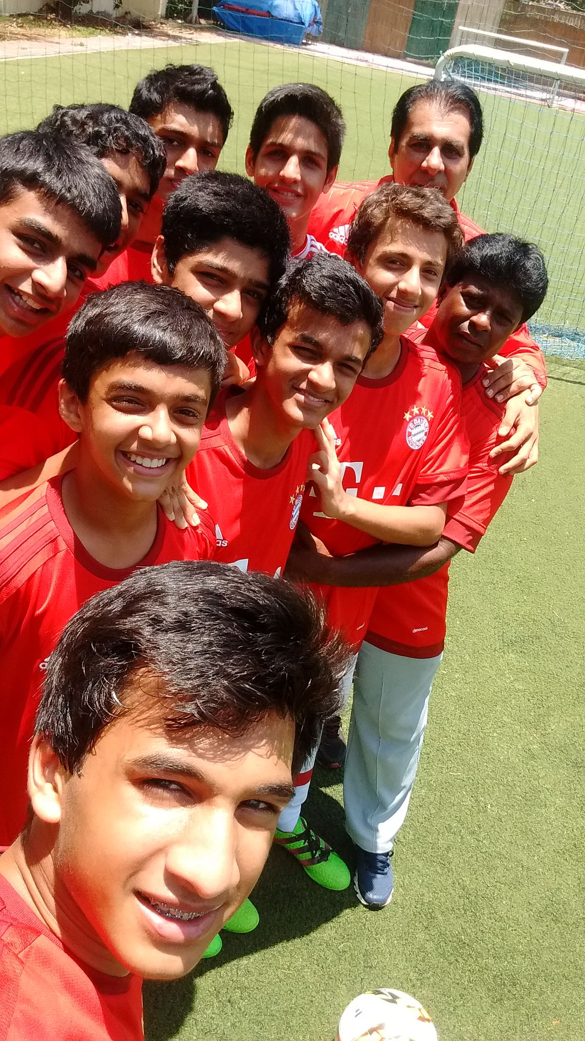 The players of the Cathedral and John Connon school team take a selfie.