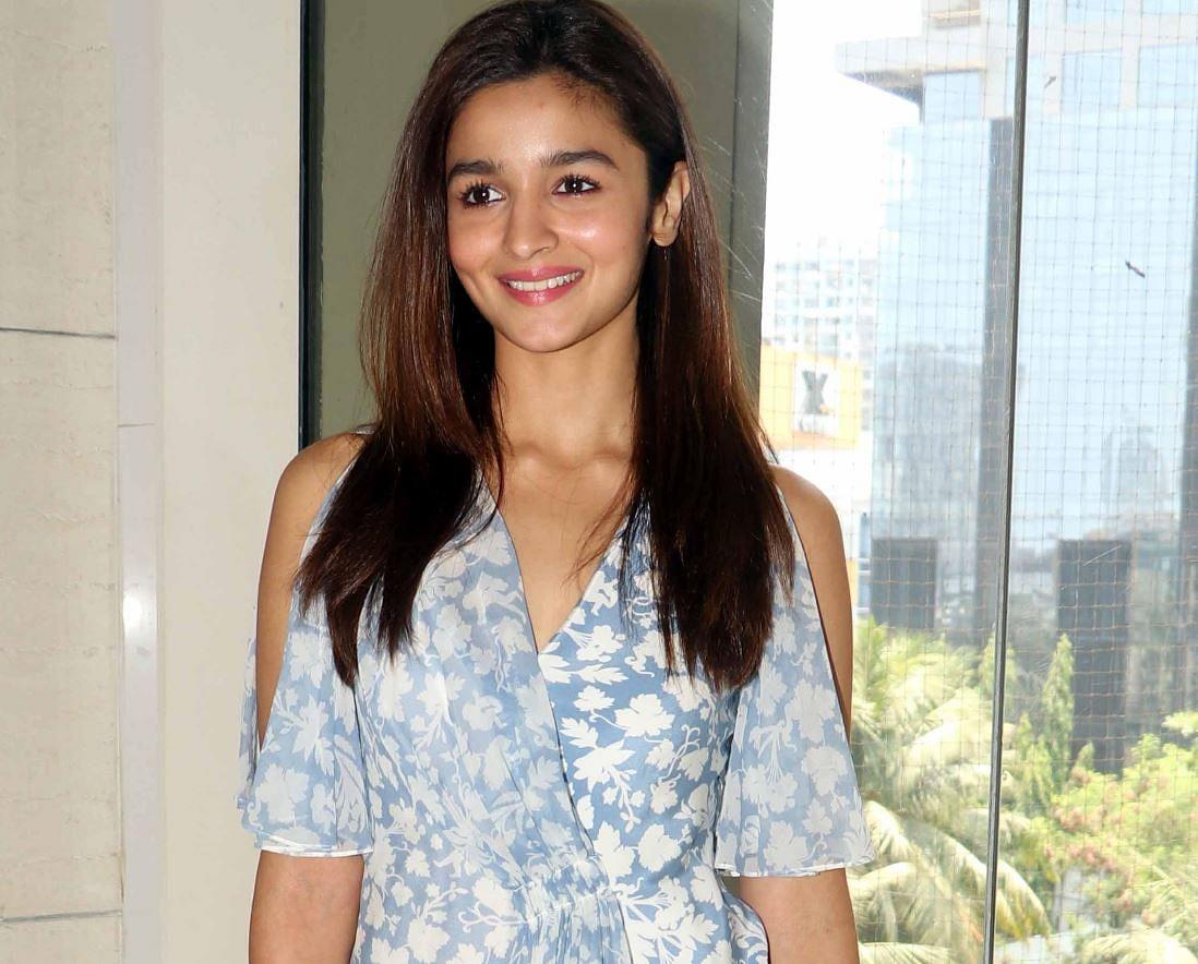 Alia Bhatt wearing a cut out shoulder dress by Topshop Unique. (Photo: Yogen Shah)