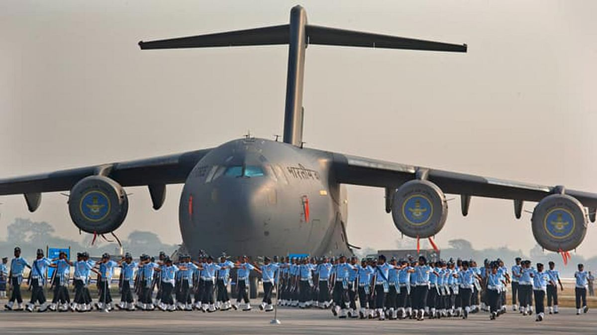 Indian Air Force soldiers march past the IAF C-17 Globemaster during the Air Force Day parade at Hindon Air Force base near New Delhi.