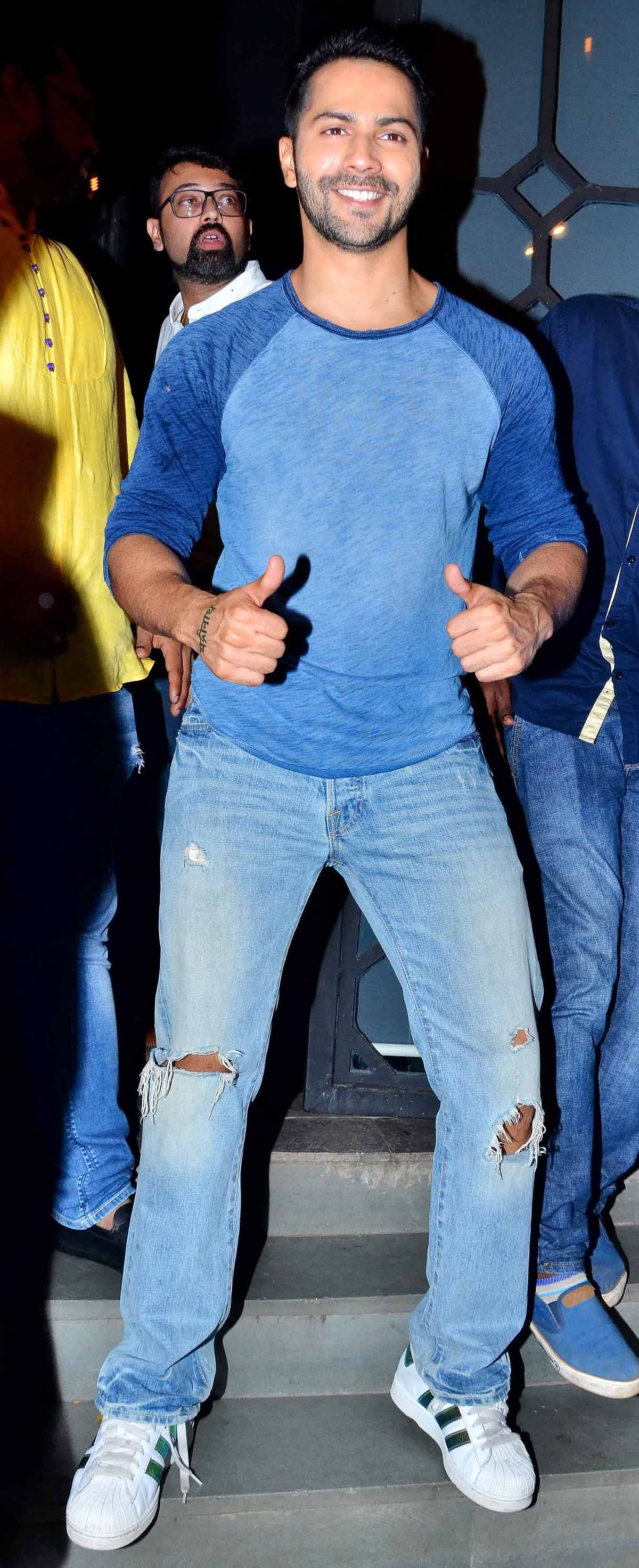 Varun Dhawan strikes a pose while arriving at the party. (Photo: Yogen Shah)