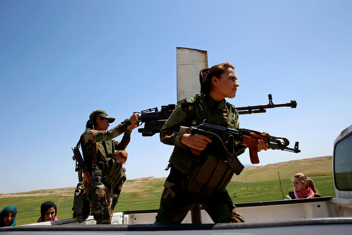 Yazidi female fighters in pickup truck during a deployment near the frontline of the fight against Islamic State militants in Nawaran near Mosul, Iraq. (Photo: Reuters)