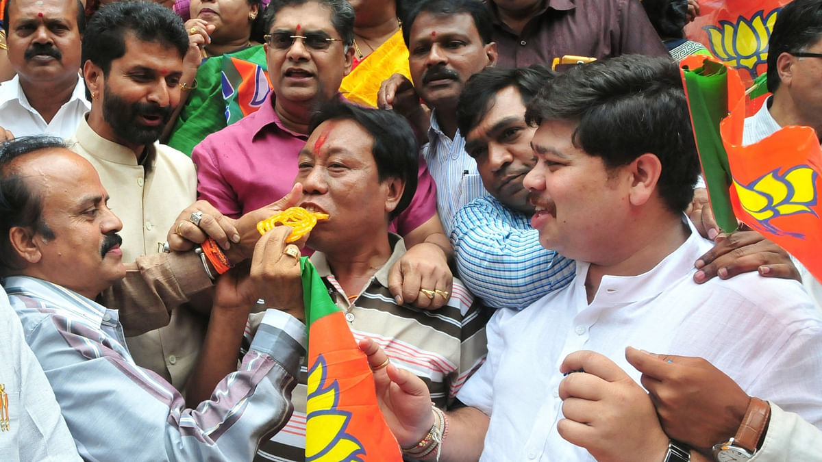 BJP workers celebrate their party's victory  in the recently concluded  Assam assembly polls, in Bengaluru, on May 19, 2016. (Photo: IANS)