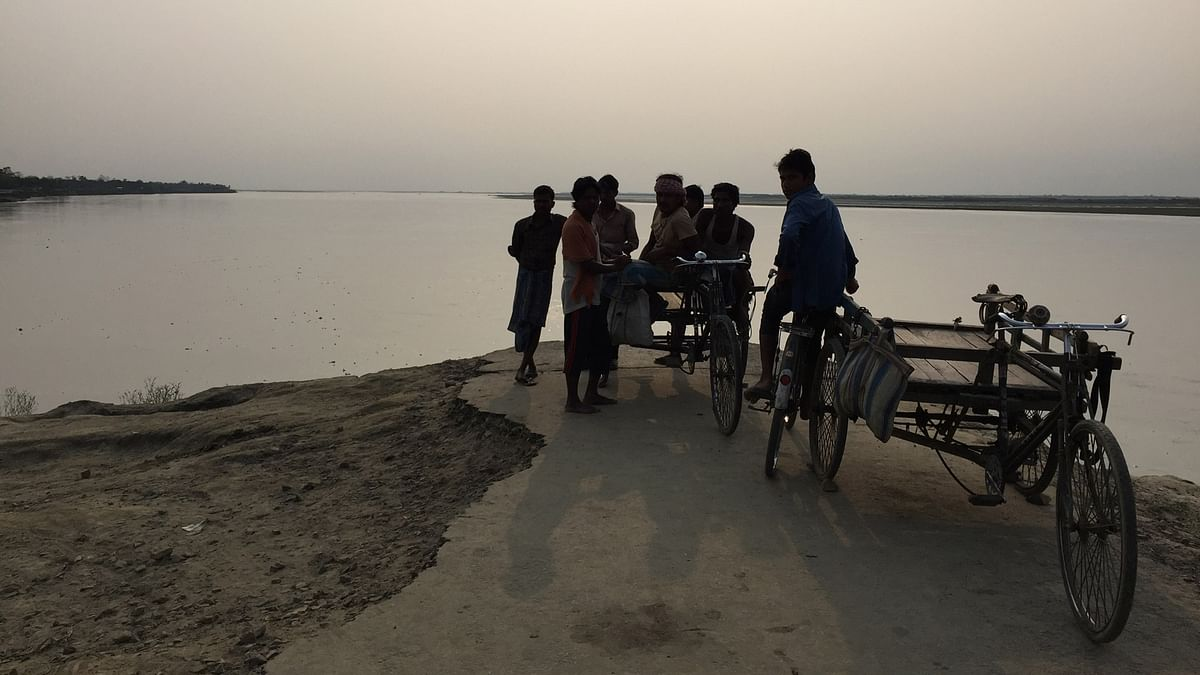 In South Salmara and its adjoining areas, soil erosion caused by the Brahmaputra for years has displaced people and destroyed property. (Photo: Tridip K Mandal/ <b>The Quint</b>)