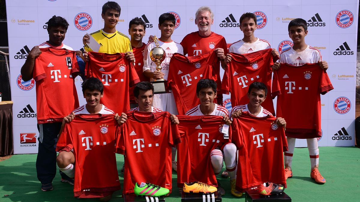 The Cathedral & John Connon School team with Bayern Munich legend Paul Breitner.