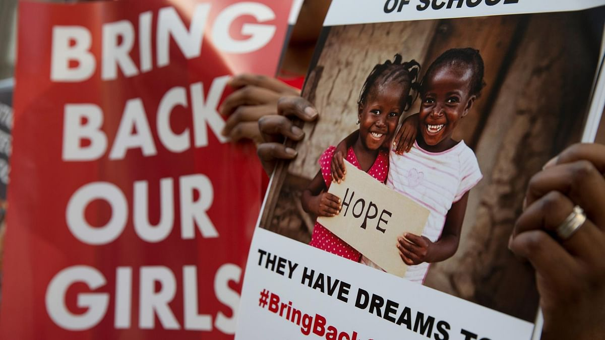 Protesters holds up placards demanding help from the Nigerian government to find the 219 girls one year their kidnapping, outside the Nigerian High Commission in London, Tuesday, 14 April 2015. (Photo: AP)