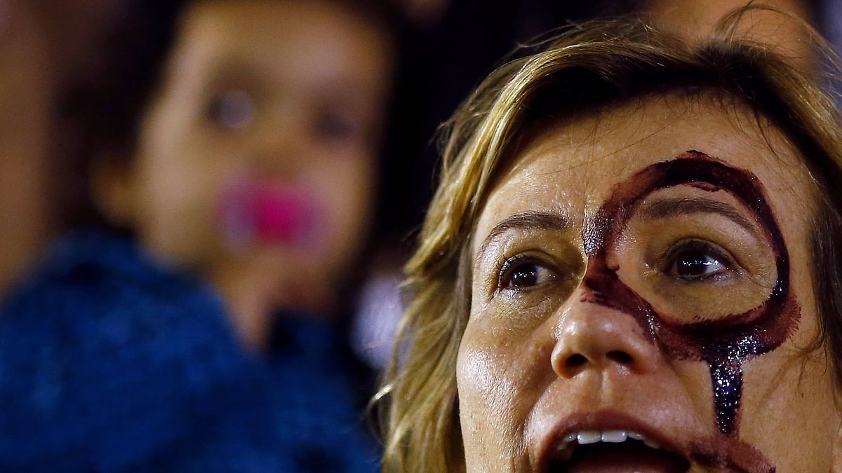 A woman attends a protest against rape and violence against women in Rio de Janeiro. (Photo: Reuters)