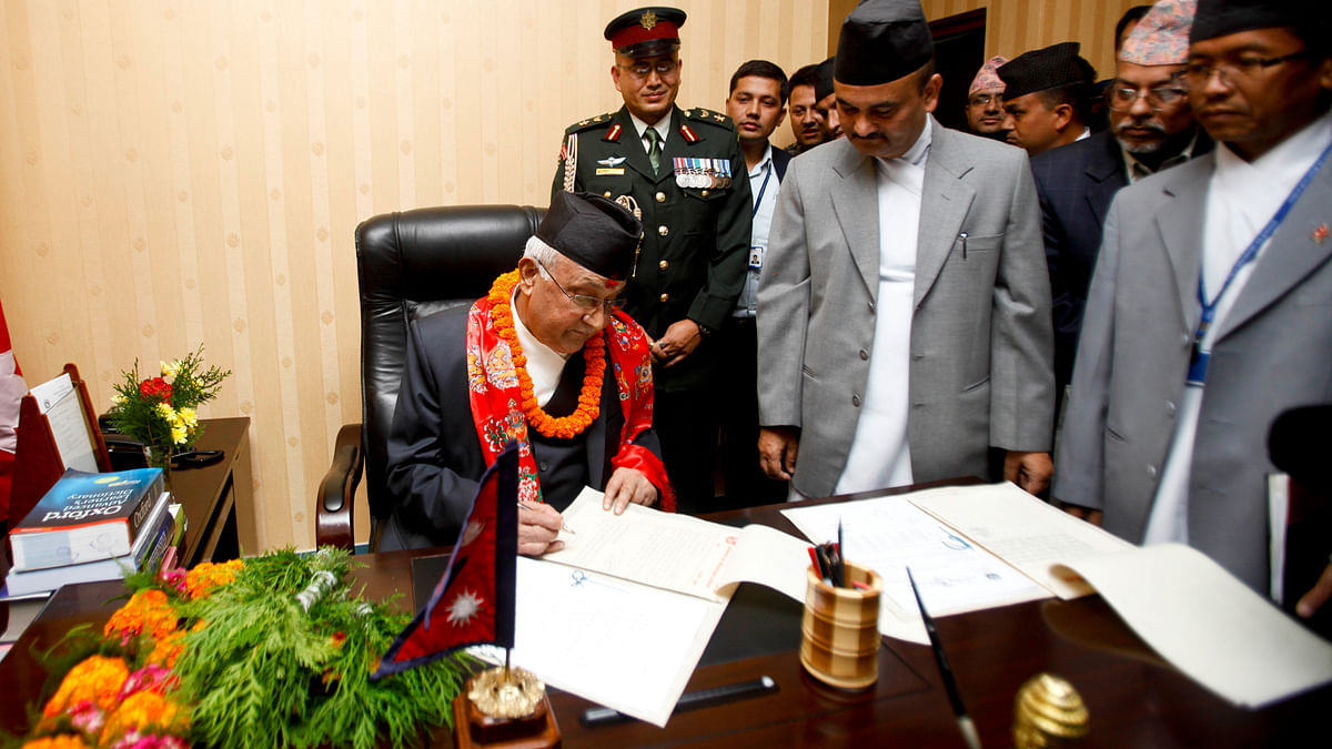 Nepal's Prime Minister Khadga Prashad Oli  assumes his post at his office in Kathmandu October 2015. (Photo: IANS)