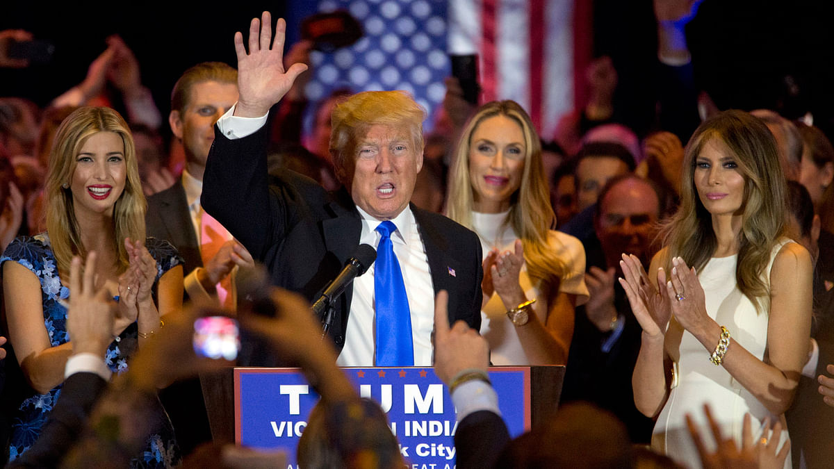 Republican presidential candidate Donald Trump is joined by his wife Melania, right, daughter Ivanka, left, as he speaks during a primary night news conference on Tuesday, 3 May  2016, in New York. (Photo: AP)