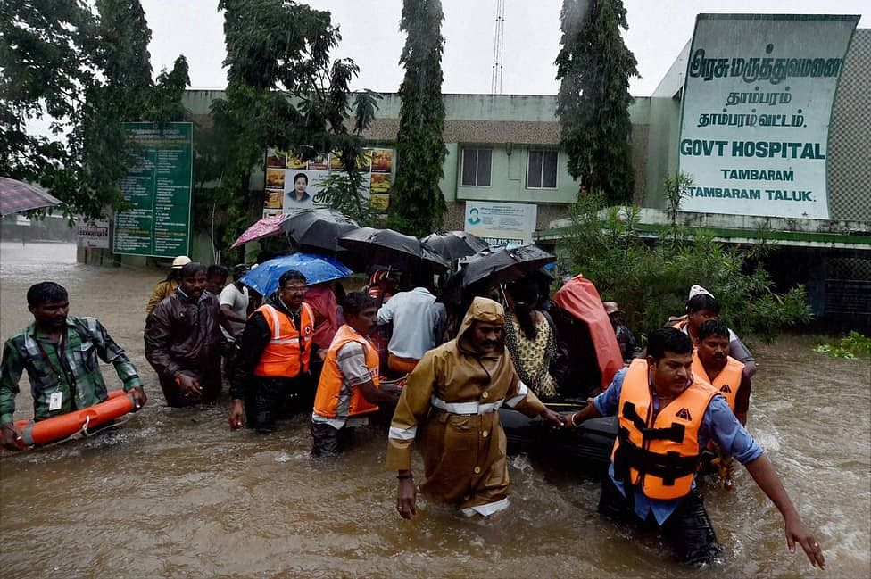 Rescuers shifting patients from a flooded hospital after heavy rains in Chennai on Tuesday. (Photo: PTI)