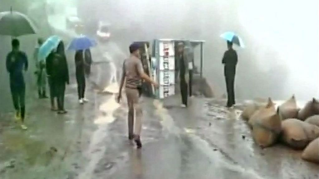 A portion of NH-102 has sunk near Tengnoupal following incessant downpour, vehicles stranded. (Photo: ANI screengrab)